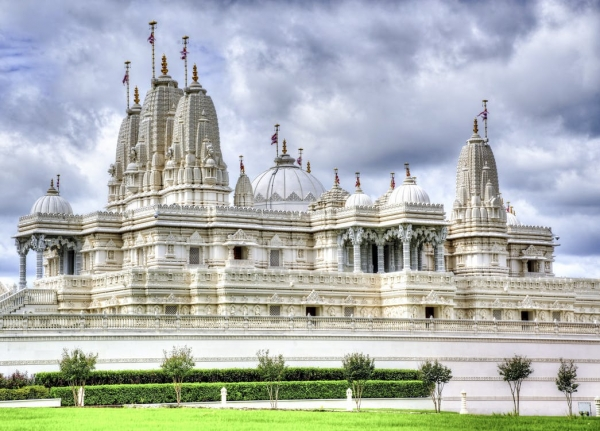 white-and-gray-temple-during-cloudy-sky-daytime